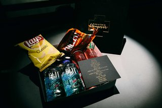 a-couples-hangover-box-for-guests-with-snacks-water-and-other-items