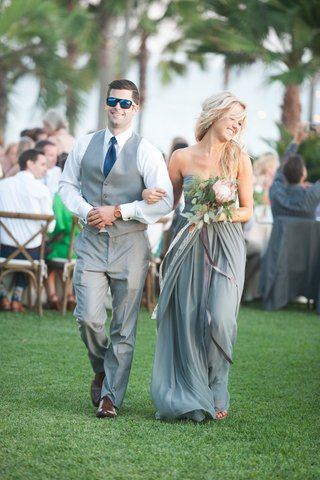 garden-wedding-with-bridesmaid-in-strapless-light-grey-dress-protea-greenery-bouquet-groomsman