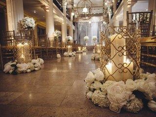 white-flowers-around-base-of-pillar-candle-holder