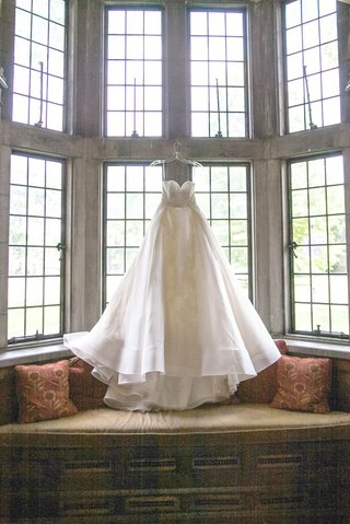 brides-gorgoeus-white-w-line-gown-with-sweetheart-neckline-hanging-in-the-window