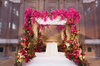 jewish-wedding-ceremony-structure-with-fuchsia-orchids-pink-and-red-roses-and-greenery