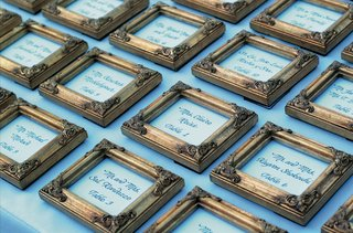white-escort-card-in-golden-frame