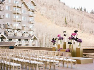wedding-ceremony-outdoors-at-montage-deer-valley-looking-at-mountain-grounds-purple-flowers-gold