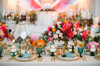 bold-floral-arrangements-white-linen-gold-chargers-plateware-rainbow-colors-wedding-reception