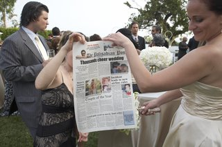 wedding-guests-holding-custom-newspaper