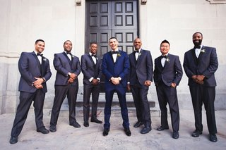 wedding-portraits-groom-and-groomsmen-navy-suits-black-bow-ties-shoes-in-front-of-vibiana