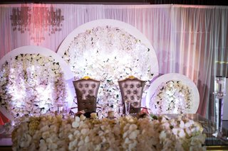 wedding-reception-sweetheart-table-royal-wedding-gold-flower-arrangements-orchids-in-white-circles