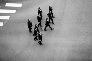 black-and-white-photo-of-groomsmen-on-street-birds-eye-view