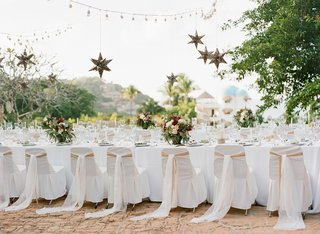 wedding-rehearsal-dinner-in-mexico-destination-welcome-party-white-chair-covers-star-lanterns