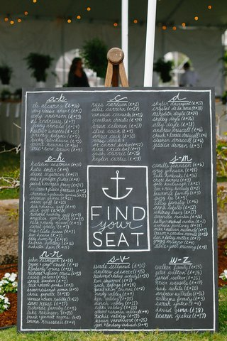 large-chalkboard-wedding-reception-seating-chart-with-names-listed-in-alphabetical-order