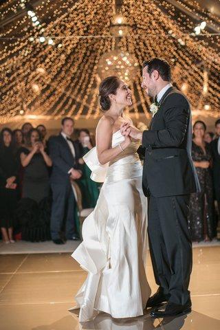 wedding-reception-first-dance-string-lights-tent-wedding-reception-oscar-de-la-renta-dress