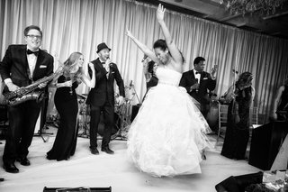 black-and-white-photo-of-bride-in-vera-wang-ball-gown-dancing-on-stage-with-live-band