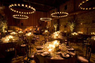 brick-building-wedding-reception-with-hundreds-of-candles
