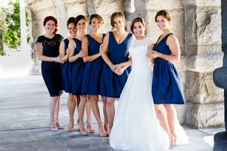 bride-in-a-line-gown-with-bridesmaids-in-short-v-neck-cocktail-dresses-hair-updo