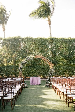 wedding-ceremony-wood-chairs-white-cushion-purple-linen-circle-branch-greenery-purple-flowers-unique