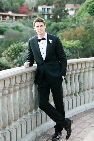 groom-in-a-classic-black-tuxedo-with-black-bow-tie