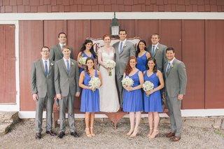bridesmaids-in-blue-and-groomsmen-in-grey