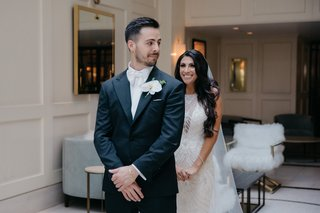 wedding-first-look-photo-bride-in-maggie-sottero-wedding-dress-groom-in-white-tie-tuxedo
