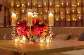 wedding-weekend-welcome-dinner-with-a-wall-of-candles-and-candles-in-decorative-crystal-holders