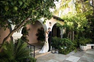 wedding-portrait-bride-in-inbal-dror-groom-at-hotel-bel-air-wedding-venue-in-los-angeles-california