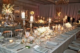 wedding-reception-in-chicago-with-white-pink-flower-centerpiece-and-candle-holders