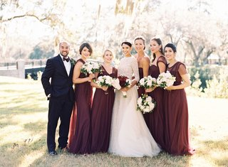 bride-in-long-sleeve-lace-wedding-dress-with-five-bridesmaids-in-long-burgundy-dresses-sleeveless