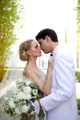 couple-close-embrace-first-look-liancarlo-gown-dress-champagne-embellishments-bouquet-white-suit
