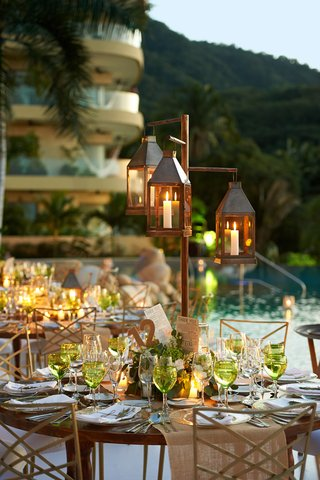 outdoor-poolside-wedding-reception-with-rustic-centerpieces