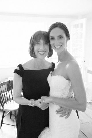 black-and-white-photo-of-bride-in-pnina-tornai-for-kleinfeld-wedding-dress-holding-mother-of-bride