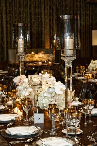wedding-reception-with-modern-supper-club-inspired-design-leather-gold-rim-white-orchid-rose-charger