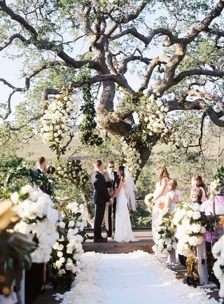bride-and-groom-holding-hands-under-oak-tree