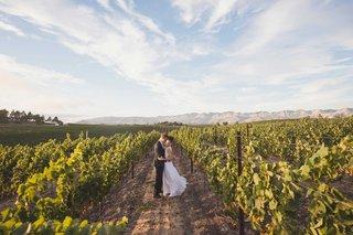 bride-in-mira-zwillinger-wedding-dress-from-carines-bridal-atelier-in-vineyard-winery-slo