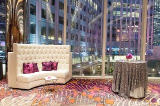 elegant-las-vegas-wedding-lounge-area-with-high-back-white-sofa-silver-sequin-table-cloth