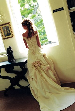 back-of-wedding-dress-with-corset-bodice-and-roses