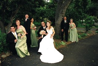bride-and-groom-with-green-bridesmaids-in-woods