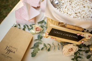 wedding-ceremony-flavored-popcorn-station-with-kraft-paper-custom-bags-chalkboard-sign-white-cheddar