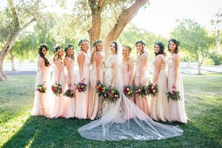 bride-in-a-claire-pettibone-dress-with-gold-and-silver-embroidery-bridesmaids-in-pale-pink-dresses