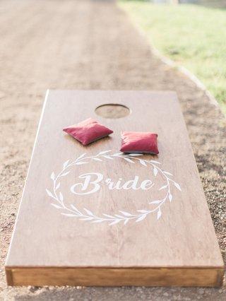 wooden-cornhole-board-beanbags-custom-california-boho-chic-wedding-styled-shoot-entertainment-rustic