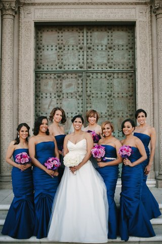 bride-with-african-american-bridesmaids-in-royal-blue-dressses