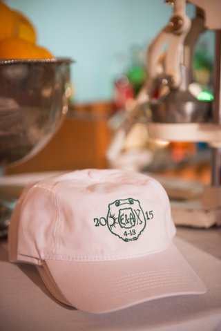 couples-favors-were-pink-hats-with-custom-logos-embroidered-to-honor-childhood-camp-where-they-met