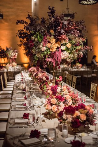head-table-for-26-guests-spanish-theme-inspired-in-shades-of-burgundy-orange-green-florals-desig