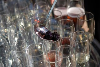 champagne-toasting-glasses-filled-with-fruit