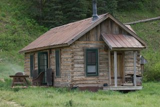 old-wood-cabin-in-grass-mountain-region