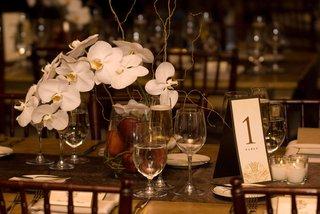 rustic-wedding-reception-orchid-centerpiece