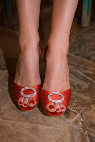 red-pedicure-and-red-wedding-heels-with-rhinestone-buckle