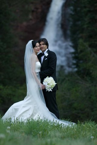 bride-and-groom-in-front-of-colorado-waterfall