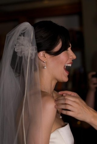 side-of-brides-head-with-veil-and-red-lips