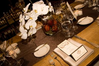 black-tie-wedding-reception-table-in-rustic-setting