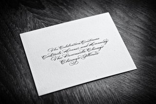 black-and-white-photo-of-reception-card-with-calligraphy