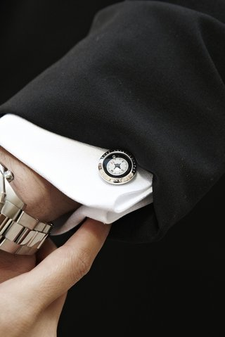 silver-compass-cufflink-on-grooms-tuxedo-shirt-cuff